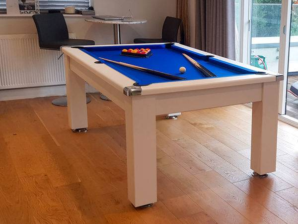 35984-Signature Warwick Pool Dining Table in White finished with a Blue Cloth